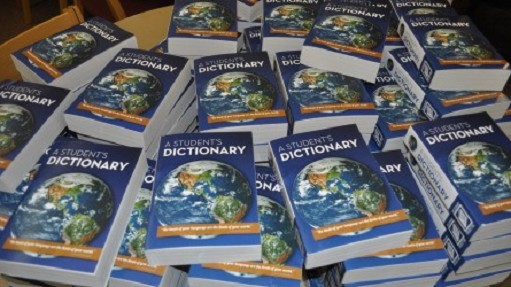 One of our many community service projects is to donate dictionaries to third graders at Cherry Brook Elementary School.
